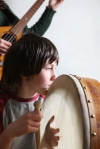 playing on bodhran at a traditional session